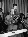Man Testing Our Power Steering at General Motors Motorama Car Show