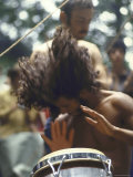 Drummer Playing Instrument with Hands During Woodstock Music Festival