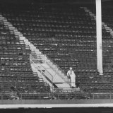 Lone Sailor Standing in an Empty Section of Ebbet's Field
