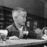 Little Boy Drinking a Soda at a Local Drugstore