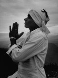 Buddhist Pilgrim Praying on Top of Sacred Mountain of Sri Pada in Ceylon