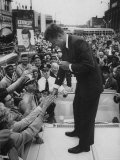 Senator John F Kennedy Speaking on the Hood of a Car During a Campaign Tour