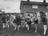 British Children Playing Outdoor Games in London Suburbs