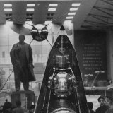 Space Satellite Exhibit and Statue of Nikolai Lenin in Soviet Pavilion  at Brussels World's Fair