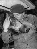 Man Spending Time with His Pet Boar