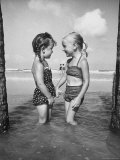 Little Girls Playing Together on a Beach
