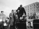 Presidential Candidate John F Kennedy Leaping from His Car While Campaigning