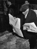 "News Vendor Sorting Through Bundles of the ""Jewish Daily Forward"""