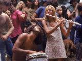 Shirtless Male Drummer and Dress Wearing Female Flutist Jamming During Woodstock Music Festival