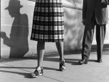 Plaid Skirt and Matching Shoes Being Modeled on the Street