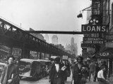 Shoppers Walking Past Elevated Railroad Running Along 6th Ave in New York City