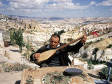 Turkish Man Playing a Type of Mandolin Called a Sis