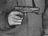 View of a Soldier Holding a US Army Colt Automatic 45 Caliber Pistol