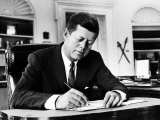 President John F Kennedy Working at His Desk in the Oval Office of the White House