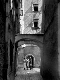 Three Young Women Chatting in Cobbled Alleyway of Old Section of Salzburg