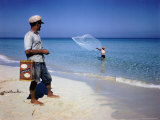Man Watching Fisherman with a Net Working Along Varadero Beach