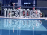 "School Children Playing on Olympic Logo ""Mexico 68"" Beside Pool"