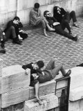 Parisian Beatniks Hanging Out on Bank of the Seine