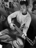 Young Japanese Nisei Playing Guitar in the Stockade at Tule Lake Segregation Center