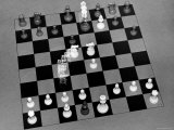Stroboscopic Image of Chess Pieces Moving on Chess Board