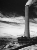 View of a Smoke Stack and Reclamation Buildings at the Very Top of the Hill
