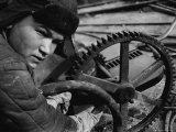 Russian Steel Worker Turning Gear Wheel in a Steel Mill