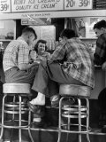 Young Men in Plaid Shirts Drinking Ice Cream Sodas at Soda Fountain