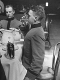 West Point Cadet Drinking a Glass of Water as He Sits at Attention in Mess Hall at the Academy