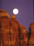 Moon over Orange Striated Rock Structures in Canyonlands National Park  Utah