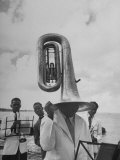 Tuba Player Keeping His Head Dry in a Rainstorm During Visit to St Croix by Pres Harry S Truman