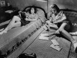 Twin Teenage Girls Reading and Writing Letters in Their Room