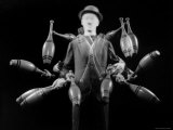 Stroboscopic Image of Juggler Stan Cavenaugh Juggling Tenpins