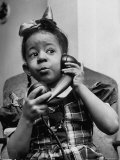 Young Girl Talking to Santa Claus on the Telephone