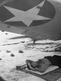 US Pilot Sleeping under Wing of His Bomber at the Midway Naval Base