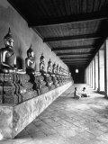 Young Buddhist and Boy on Inner Courtyard Near Buddhist Shrine