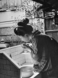 Novice Geisha Washing Her Face at a Basin