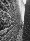 Young Man Standing in a Narrow Passageway of the Valley Ruins