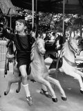 Young Turkish Prodigy Hassan Kaptan Riding a Merry Go Round