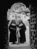 Nuns in Doorway of Chapel at Espada Mission Instructing Local Girl