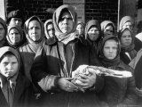 Russian Woman Grimly Holding a Slab of Meat as Other Peasant Women Staunchly Stand By