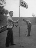 Son Cary Caddying For His Father
