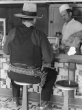 Movie Cowboy Sitting at Soda Fountain Counter During Break in Shooting