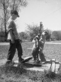 Two Boys Getting Water from a Pump at Rural School