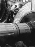 Workman on Large Wheel That Looks Like Fan  at General Electric Laboratory