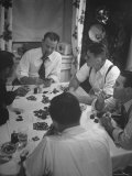 Men Playing Poker at Dining Room Table Covered with Chips  Cards  Ashtrays and Glasses