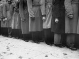 Men in Ill Fitting Coats Lining Up to Enlist in Well Dressed Guards