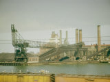 Photo Taken from Window of a Train Showing Industrial Waterfront Scene