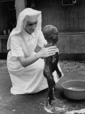 Sister Therese is Bathing a Child Suffering from Protein Deficiency Disease