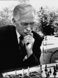Older Man  with Thoughtful Expression  Playing Chess