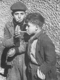 Two Homeless Boys Lighting Up American Cigarettes with British Matches